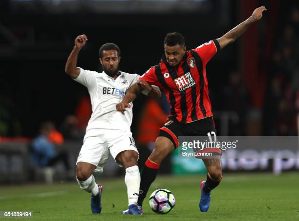 Wayne Routledge of Swansea City and Joshua King of AFC Bournemouth battle for possession during the Premier League match between AFC Bournemouth and...