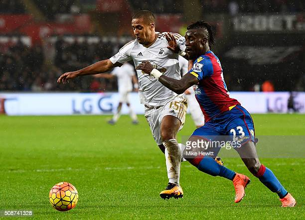 Wayne Routledge of Swansea City and Pape N'Diaye Souare of Crystal Palace compete for the ball during the Barclays Premier League match between...