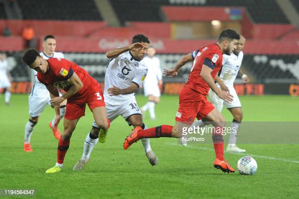 Wayne Routledge of Swansea City battle for possession with Antonee Robinson and Sam Morsy Wigan of Athletic during the Sky Bet Championship match...