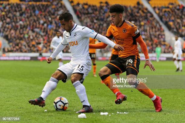 Wayne Routledge of Swansea City challenged by Morgan GibbsWhite of Wolverhampton Wanderers during the Emirates FA Cup match between Wolverhampton...