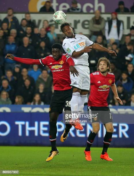 Wayne Routledge of Swansea City challenged for a header by Axel Tuanzebe of Manchester United during the Carabao Cup Fourth Round match between...