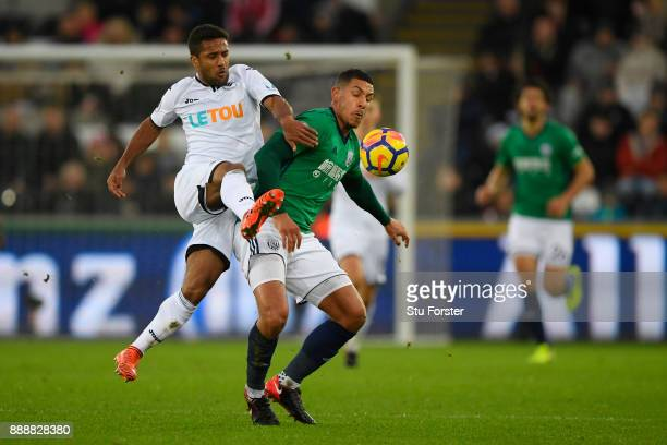 Wayne Routledge of Swansea City challenges Jake Livermore of West Bromwich Albion during the Premier League match between Swansea City and West...