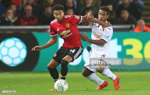 Wayne Routledge of Swansea City challenges Jesse Lingard of Manchester United during the Carabao Cup Fourth Round match between Swansea City and...