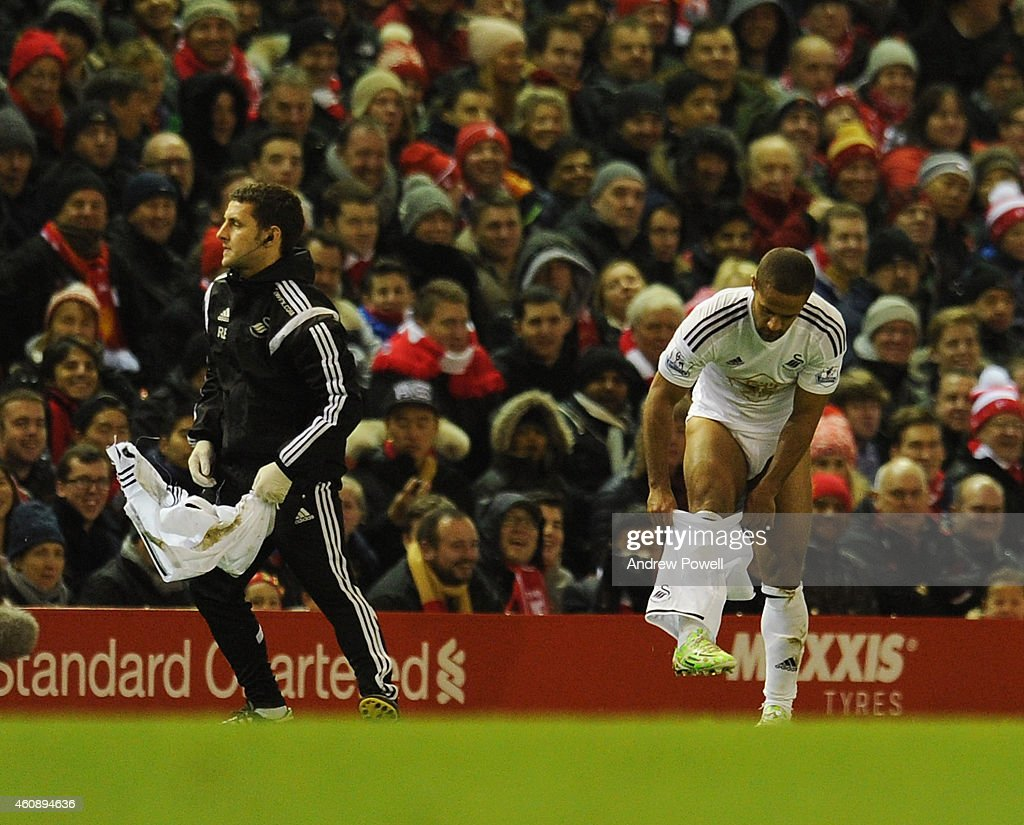 Wayne Routledge of Swansea City changes his shorts during the Barclays Premier League match between Liverpool and Swansea City at Anfield on December 29, 2014 in Liverpool, England.