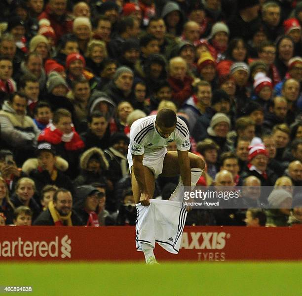 Wayne Routledge of Swansea City changes his shorts during the Barclays Premier League match between Liverpool and Swansea City at Anfield on December...