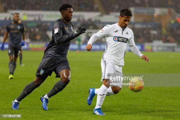 Wayne Routledge of Swansea City closely followed by Lucas Joao of Sheffield Wednesday during the Sky Bet Championship match between Swansea City and...