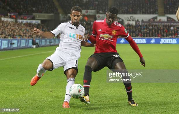 Wayne Routledge of Swansea City is challenged by Axel Tuanzebe of Manchester United during the Carabao Cup Fourth Round match between Swansea City...