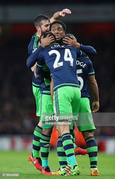 Wayne Routledge of Swansea City is congratulated by teammates after scoring the equalising goal during the Barclays Premier League match between...