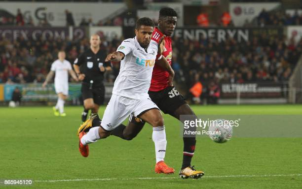 Wayne Routledge of Swansea City is marked by Axel Tuanzebe of Manchester United during the Carabao Cup Fourth Round match between Swansea City and...