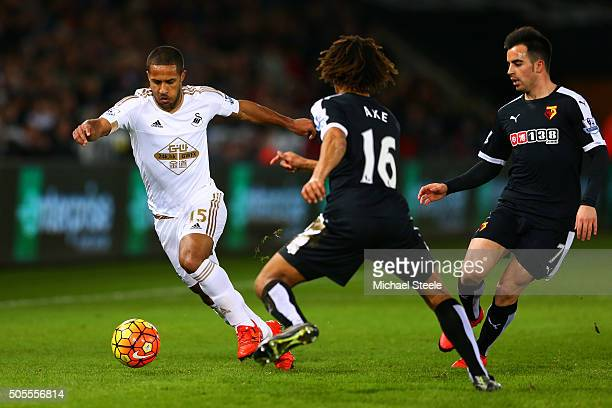 Wayne Routledge of Swansea City runs with the ball at Nathan Ake and Jose Manuel Jurado of Watford during the Barclays Premier League match between...
