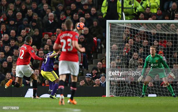 Wayne Routledge of Swansea City scores the opening goal during the FA Cup with Budweiser Third round match between Manchester United and Swansea City...
