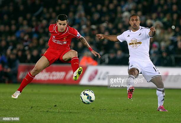 Wayne Routledge of Swansea has his shot blocked by Philippe Coutinho of Liverpool during the Premier League match between Swansea City and Liverpool...