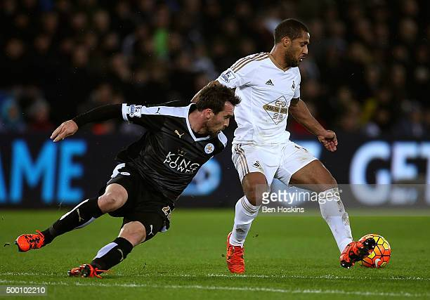 Wayne Routledge of Swansea holds off pressure from Christian Fuchs of Leicester during the Barclays Premier League match between Swansea City and...