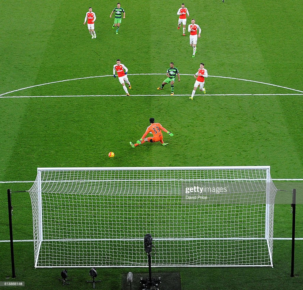 Wayne Routledge scores Swansea's 1st goal past Petr Cech of Arsenal during the Barclays Premier League match between Arsenal and Swansea City at Emirates Stadium on March 2, 2016 in London, England.