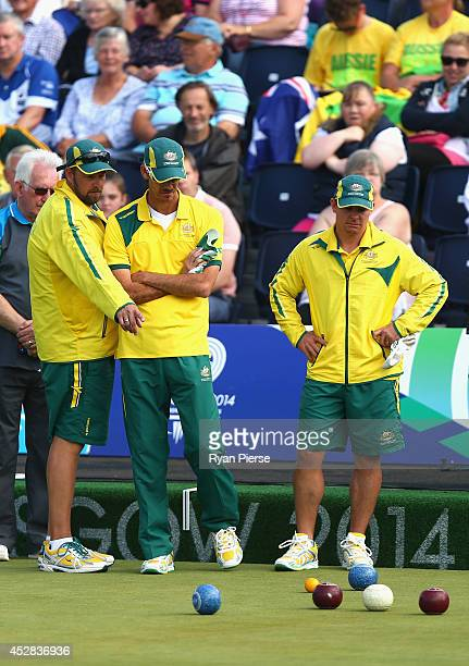 Wayne Ruediger Nathan Rice and Matt Flapper of Australia look on during the Men's Triples Bronze Final at Kelvingrove Lawn Bowls Centre during day...
