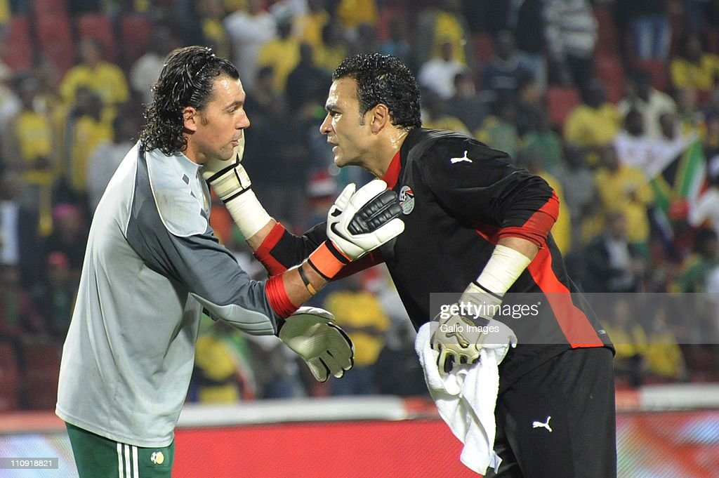 Wayne Sandilands of South Africa and Essam El-Hadary of Egypt greet each other during the 2012 Africa Cup of Nations Qualifier match between South Africa and Egypt at Coca Cola Park on March 26, 2011 in Johannesburg, South Africa.