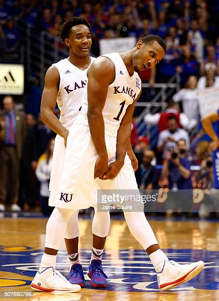 Wayne Selden Jr #1 and Devonte' Graham of the Kansas Jayhawks celebrate during the final seconds of overtime in the game against the Kentucky...