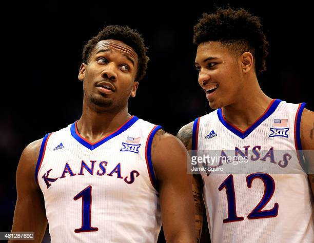 Wayne Selden Jr #1 and Kelly Oubre Jr #12 of the Kansas Jayhawks tallk during a timeout in the game against the Texas Tech Red Raiders at Allen...