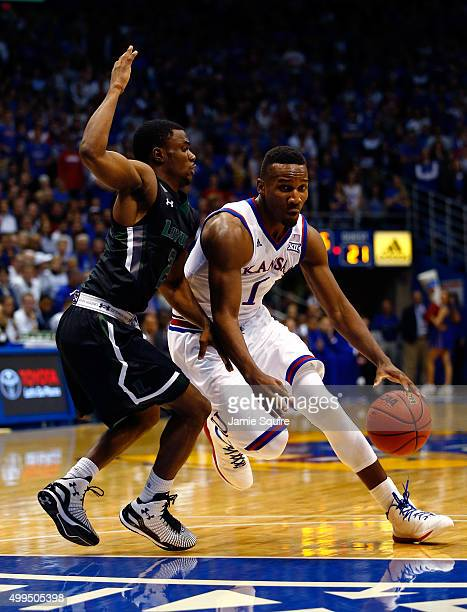Wayne Selden Jr #1 of the Kansas Jayhawks drives as Andre Walker of the Loyola Greyhounds defends during the game at Allen Fieldhouse on December 1...