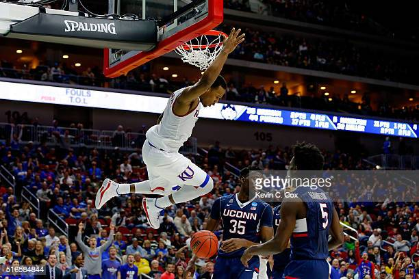 Wayne Selden Jr #1 of the Kansas Jayhawks dunks over Amida Brimah of the Connecticut Huskies in the second half during the second round of the 2016...