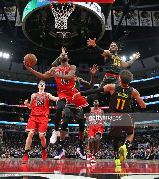 Wayne Selden of the Chicago Bulls shoots against Dewayne Dedmon DeAndre' Bembry and Trae Young of the Atlanta Hawks at the United Center on January...