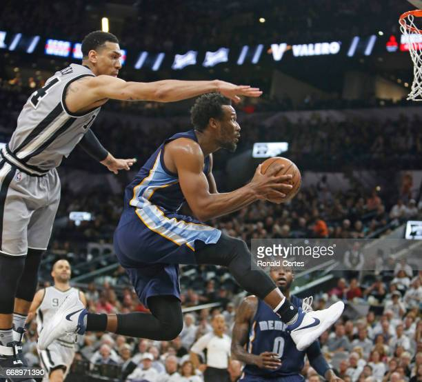 Wayne Selden of the Memphis Grizzlies drives under Danny Green of the San Antonio Spurs in Game One of the Western Conference Quarterfinals during...