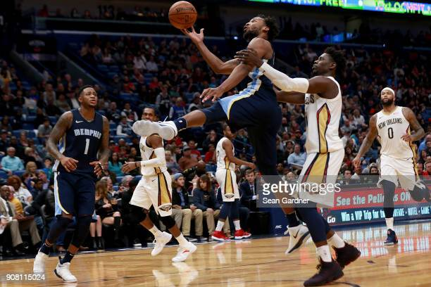 Wayne Selden of the Memphis Grizzlies is fouled by Jrue Holiday of the New Orleans Pelicans during the second half of a NBA game at the Smoothie King...