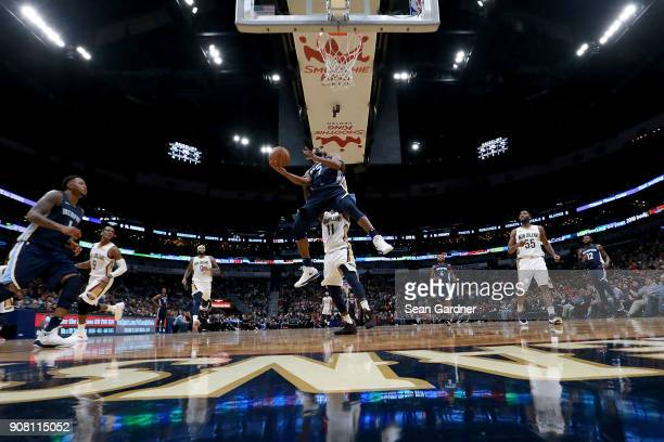 Wayne Selden of the Memphis Grizzlies shoots over Jrue Holiday of the New Orleans Pelicans during the second half of a NBA game at the Smoothie King...