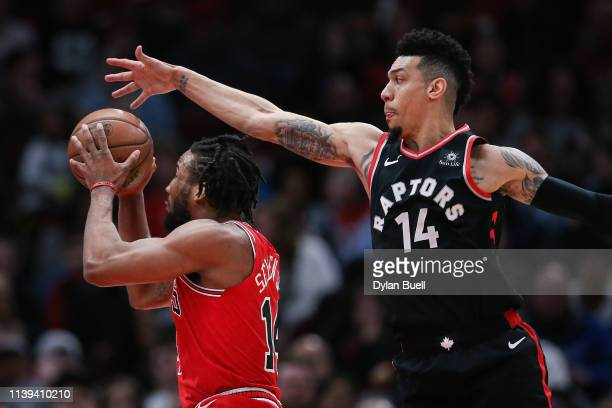 Wayne Seldon Jr #14 of the Chicago Bulls attempts a shot while being guarded by Danny Green of the Toronto Raptors in the first quarter at the United...