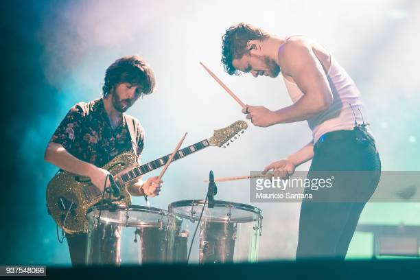 Wayne Sermon and Dan Reynolds members of the band Imagine Dragons performs live on stage during the second day of Lollapalooza Brazil Festival at...