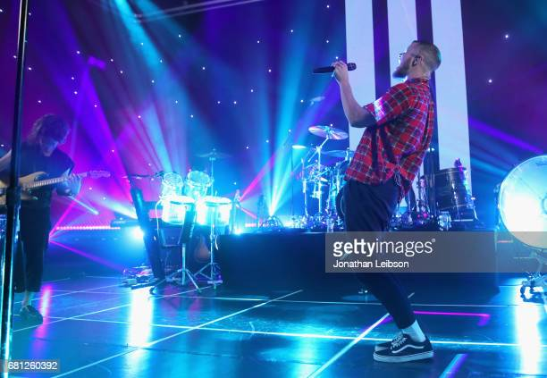 Wayne Sermon and Dan Reynolds of Imagine Dragons perform at the Evolve Tour and Album Live Stream Event at YouTube Space LA on May 9 2017 in Los...