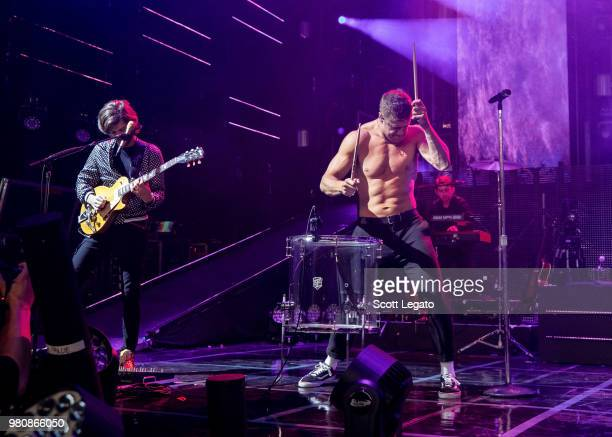 D Wayne Sermon and Dan Reynolds of Imagine Dragons perform during their Evolve World Tour 2018 at DTE Energy Music Theater on June 21 2018 in...