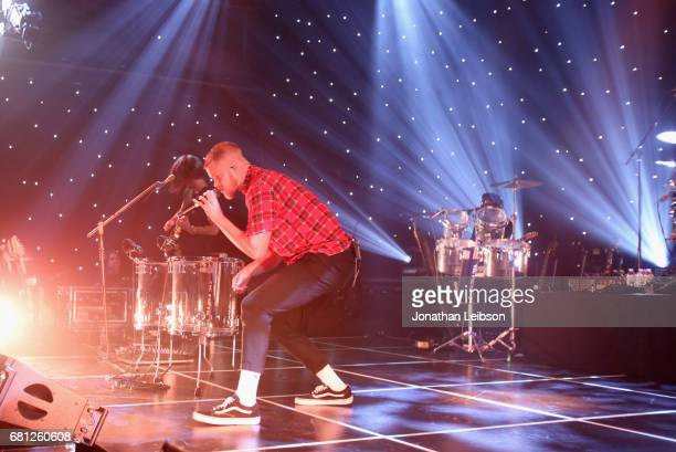 Wayne Sermon Dan Reynolds and Daniel Platzman of Imagine Dragons perform at the Evolve Tour and Album Live Stream Event at YouTube Space LA on May 9...