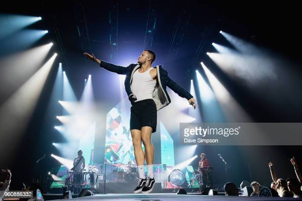 Wayne Sermon Daniel Platzman Dan Reynolds and Ben McKee of Imagine Dragons perform on stage at Spark Arena on May 21 2018 in Auckland New Zealand