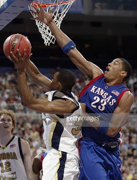 Wayne Simien of the Kansas Jayhawks blocks Anthony McHenry of the Georgia Tech Yellow Jackets during the fourth round game of the NCAA Division I...