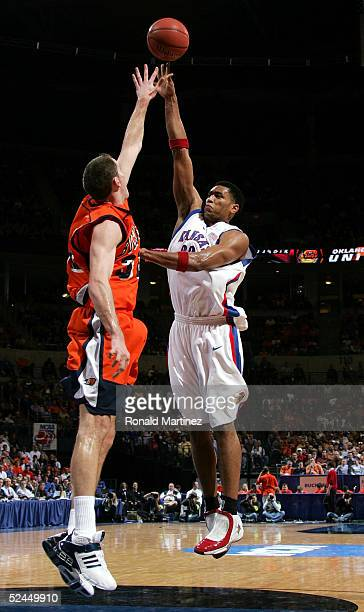 Wayne Simien of the Kansas Jayhawks shoots a hook shot over Chris McNaughton of the Bucknell Bison in the first round of the NCAA Men's Basketball...