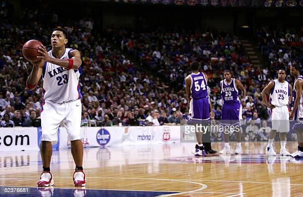 Wayne Simien of the Kansas Jayhawks shoots a technical foul free throw in the first half against the Kansas State Wildcats in Day 2 of the Phillips...