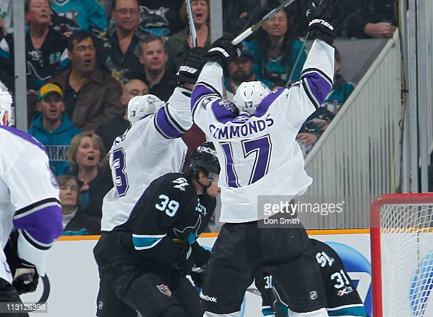Wayne Simmonds and a teammate of the Los Angeles Kings celebrate a first period goal against Antti Niemi and Logan Couture of the San Jose Sharks in...