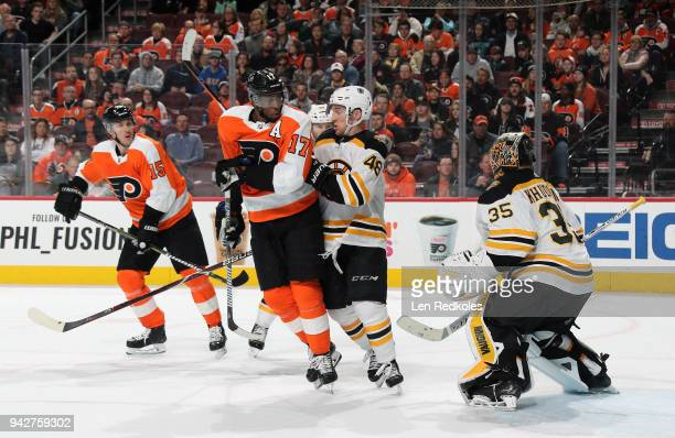 Wayne Simmonds and Jori Lehtera of the Philadelphia Flyers in action against Matt Grzelcyk and Anton Khudobin of the Boston Bruins on April 1 2018 at...