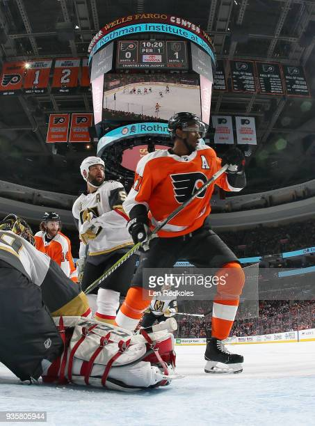 Wayne Simmonds and Sean Couturier of the Philadelphia Flyers skate through the crease against MarcAndre Fleury and Deryk Engelland of the Vegas...