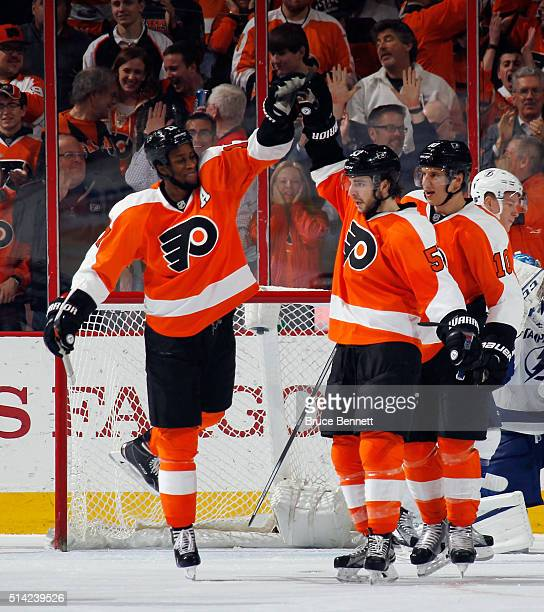 Wayne Simmonds and Shayne Gostisbehere of the Philadelphia Flyers celebrate Gostisbethere's third period goal against the Tampa Bay Lightning at the...