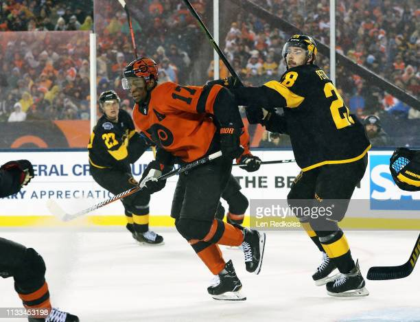 Wayne Simmonds battles against of the Philadelphia Flyers Marcus Pettersson of the Pittsburgh Penguins at the 2019 Coors Light NHL Stadium Series on...