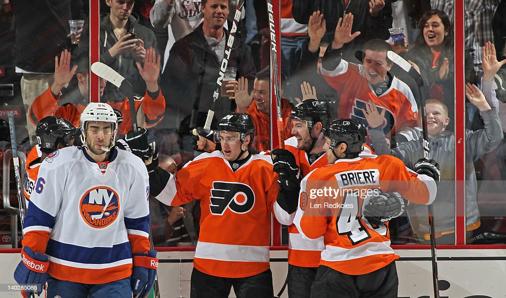 Wayne Simmonds #17, Matt Read #24, Andrej Meszaros #41, and Danny Briere #48 of the Philadelphia Flyers celebrate Read's second period goal against the New York Islanders on March 1, 2012 at the Wells Fargo Center in Philadelphia, Pennsylvania.