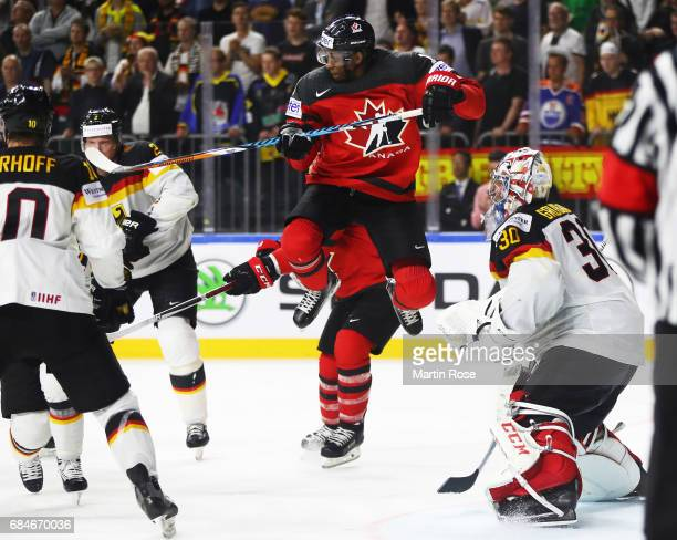 Wayne Simmonds of Canada flies high during the 2017 IIHF Ice Hockey World Championship Quarter Final game between Canada and Germany at Lanxess Arena...