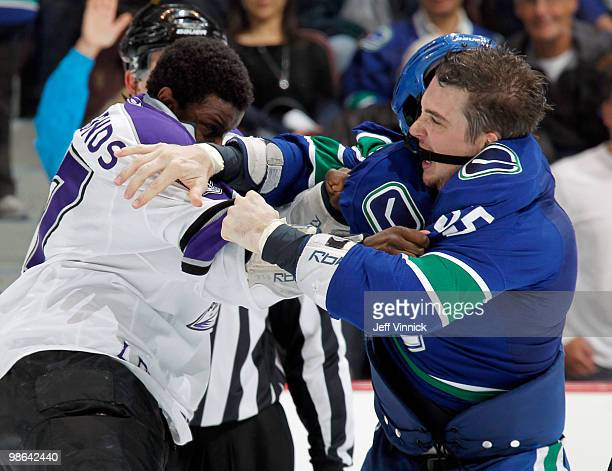 Wayne Simmonds of the Los Angeles Kings and Shane O'Brien of the Vancouver Canucks exchange punches in Game Five of the Western Conference...