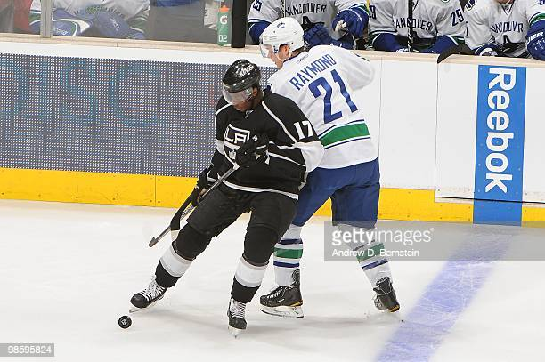 Wayne Simmonds of the Los Angeles Kings battles for the puck against Mason Raymond of the Vancouver Canucks in Game Three of the Western Conference...