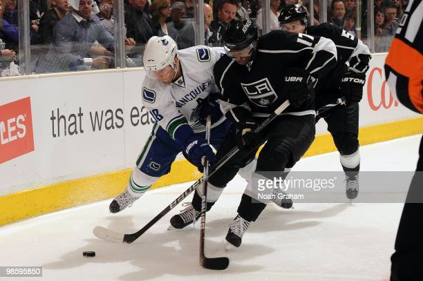 Wayne Simmonds of the Los Angeles Kings battles for the puck against Steve Bernier of the Vancouver Canucks in Game Three of the Western Conference...
