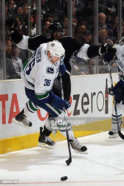 Wayne Simmonds of the Los Angeles Kings collides with Jannik Hansen of the Vancouver Canucks in Game Three of the Western Conference Quarterfinals...