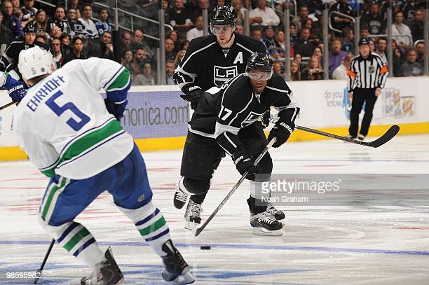 Wayne Simmonds of the Los Angeles Kings skates with the puck against Christian Ehrhoff of the Vancouver Canucks in Game Three of the Western...