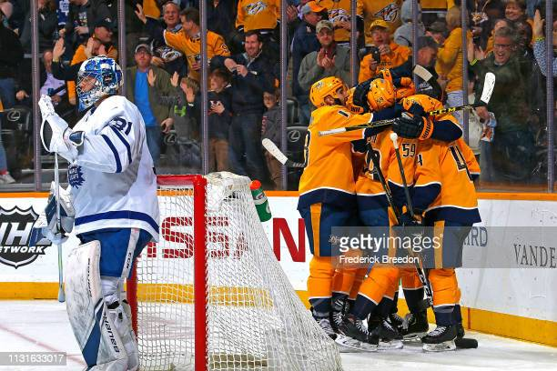 Wayne Simmonds of the Nashville Predators is congratulated by teammates after scoring a his first goal as a Predator against the Toronto Maple Leafs...